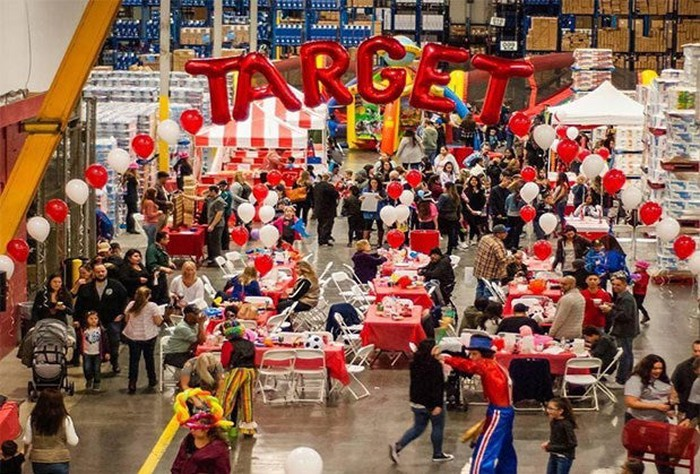 Target is spelled out in balloons inside a busy store.