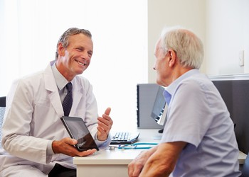 Doctor Patient Consultation With Tablet Getty