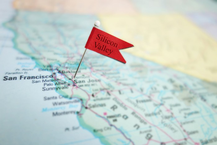 A Silicon Valley flag pinned to a paper map.