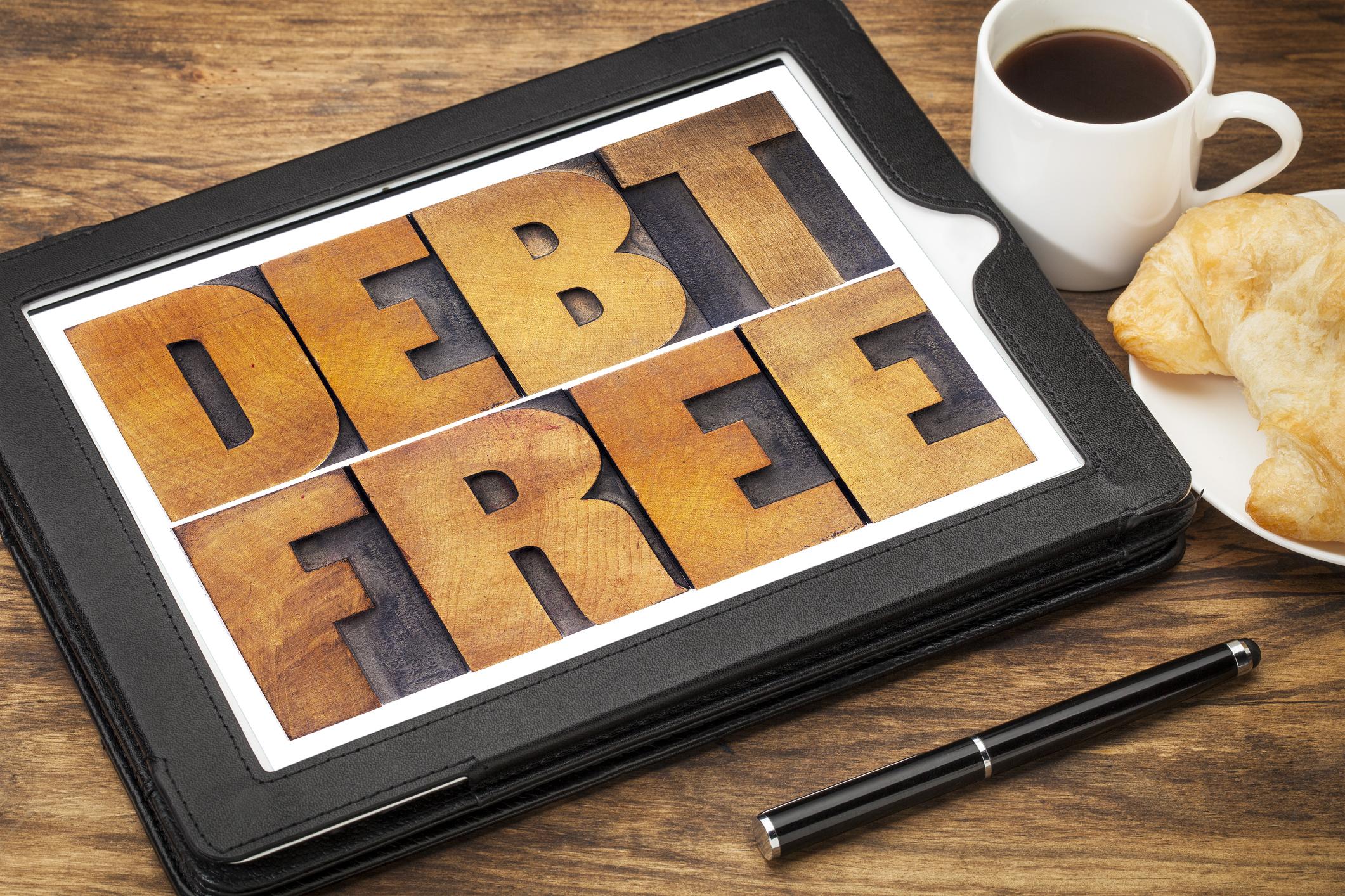 """Debt Free"" plaque"