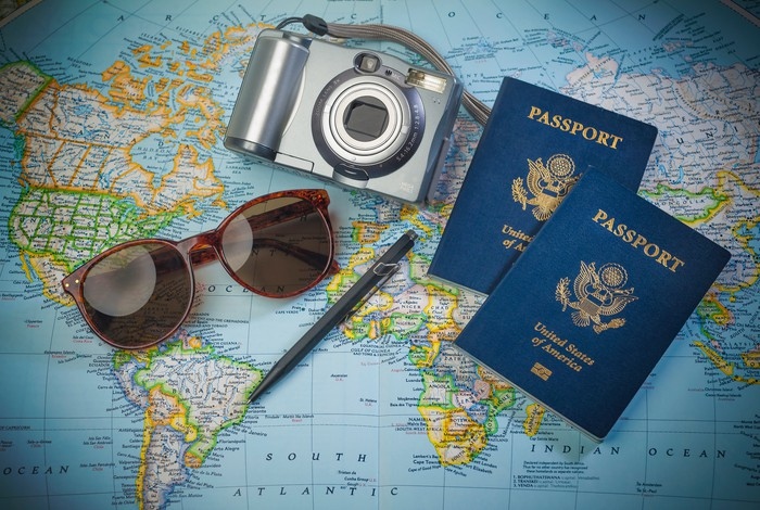 Glasses and passport on a travel map