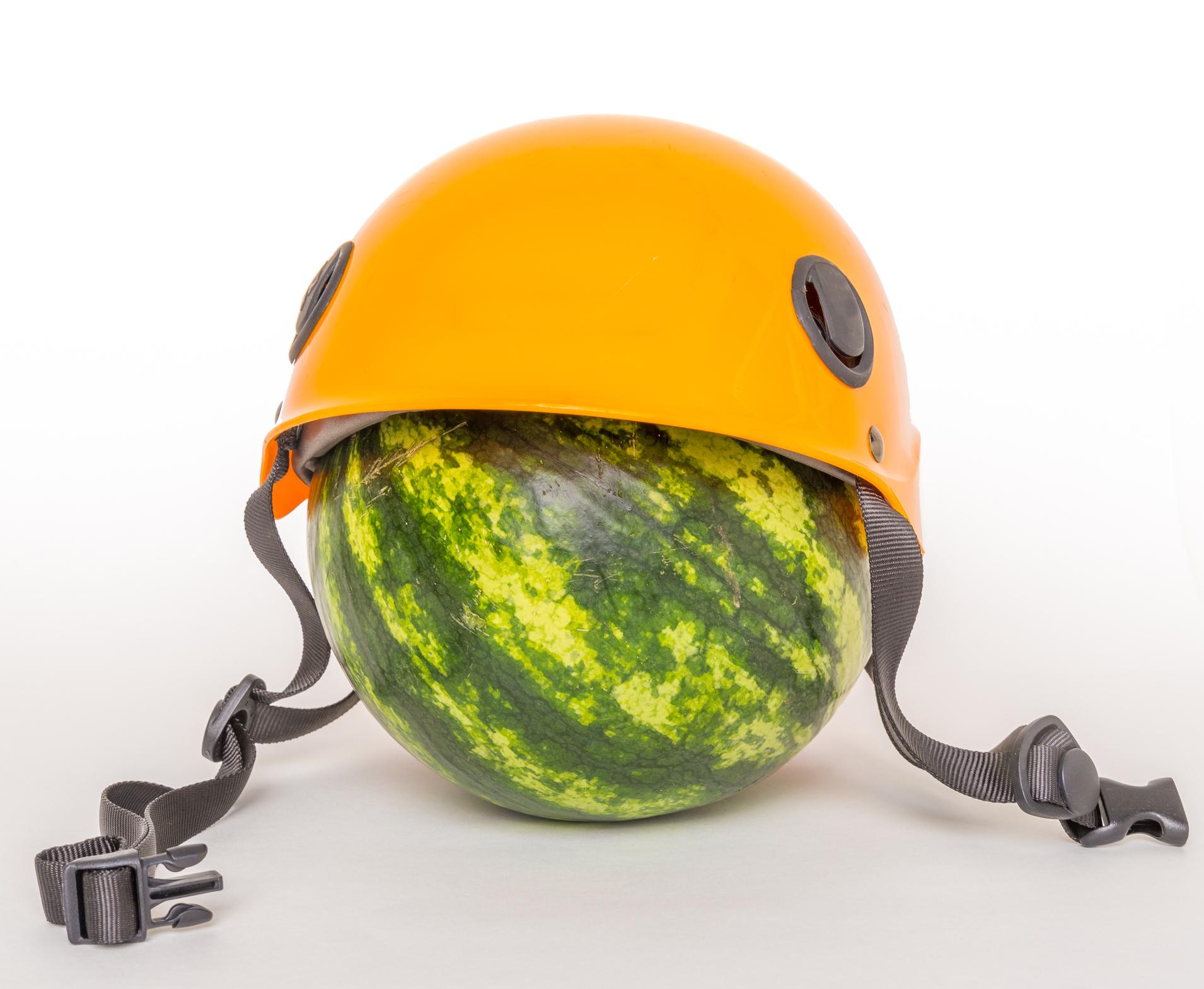 A watermelon wearing a helmet.