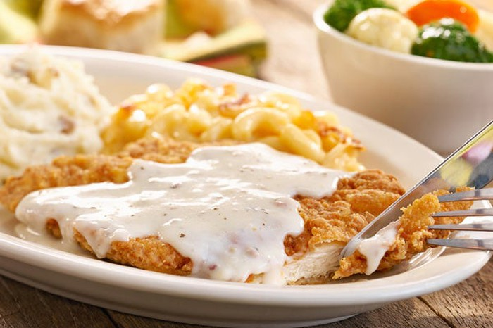 A plate of chicken fried steak with gravy, potatoes, and mac and cheese from Cracker Barrel.