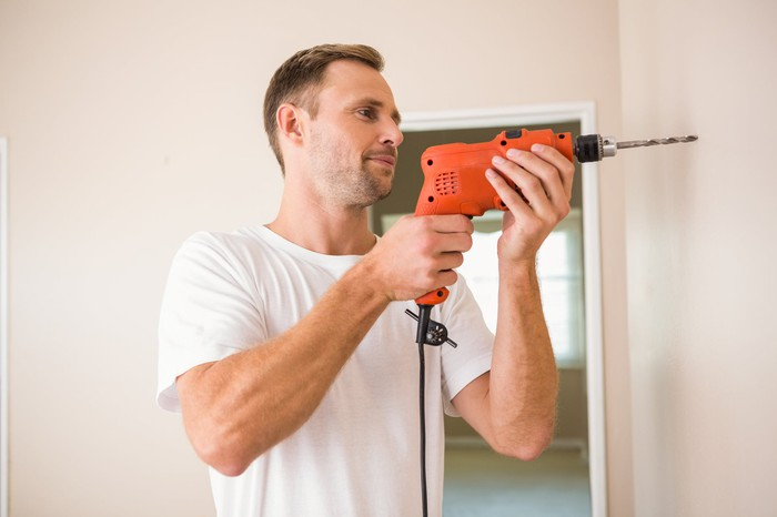 A man using a power drill.