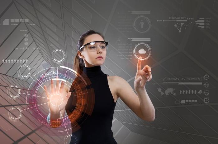 A woman using an AR interface.