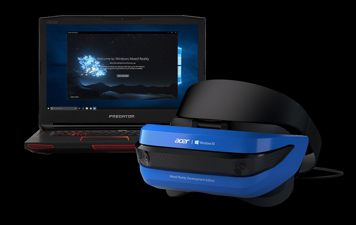 Virtual reality headset sitting next to computer.