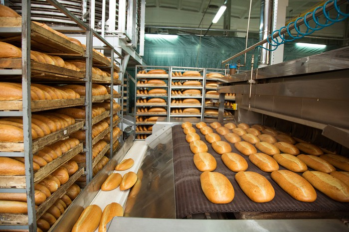 Bread being produced at bakery.