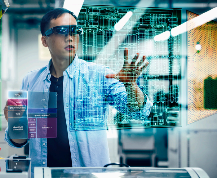 Man wearing glasses working in an AR environment