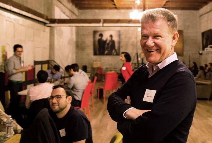 Colin Walsh standing in the foreground of a room. Walsh is a co-founder and CEO of Varo Money.
