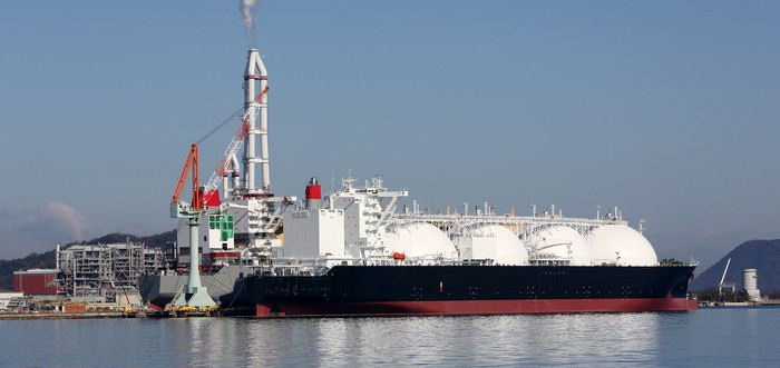 Liquefied natural gas carrier at port.