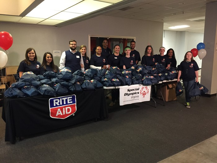 Table with Rite Aid volunteers for Special Olympics.
