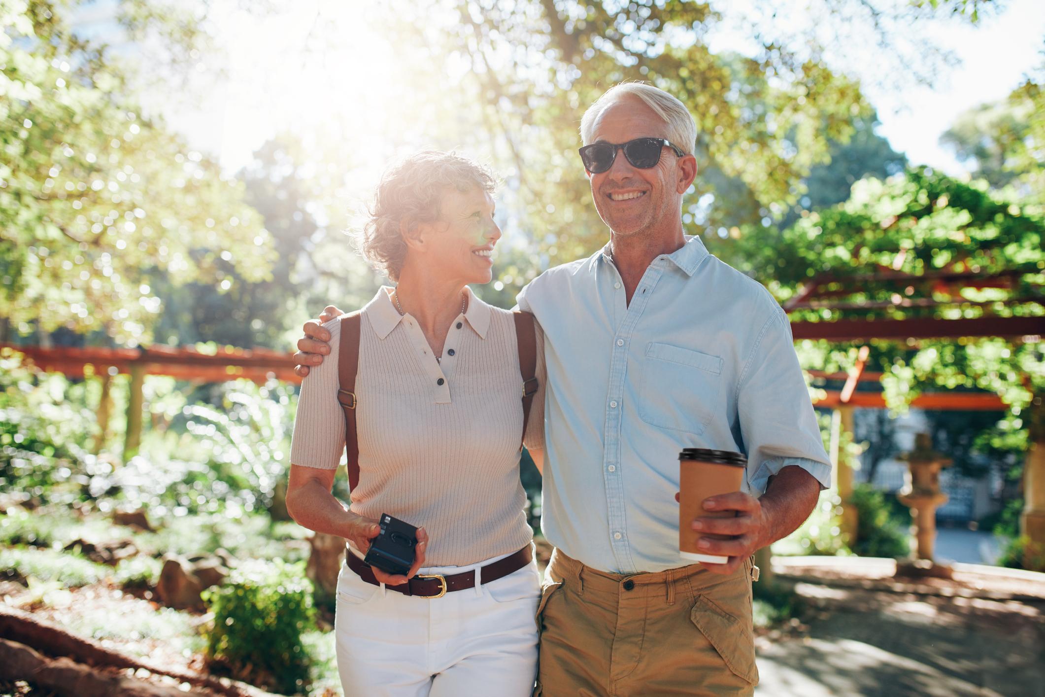Senior couple outdoors, smiling