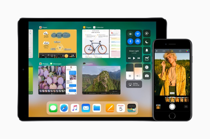 An Apple iPad on the left and an iPhone on the right, both running the upcoming iOS 11 operating system.