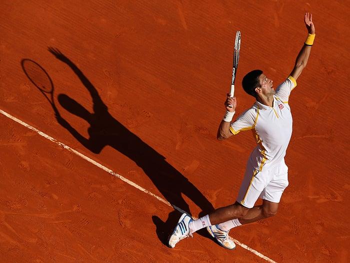 Novak Djokovic prepares for a serve.