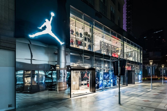 Michael Jordan's Jumpman Logo shines over a basketball court inside Nike's new Beijing store