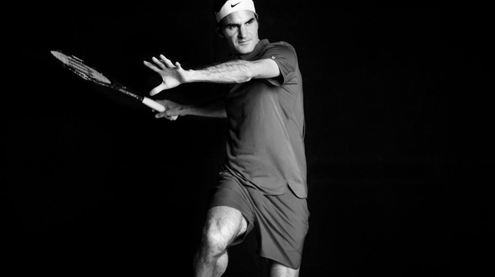 Roger Federer prepares to swing his racquet.
