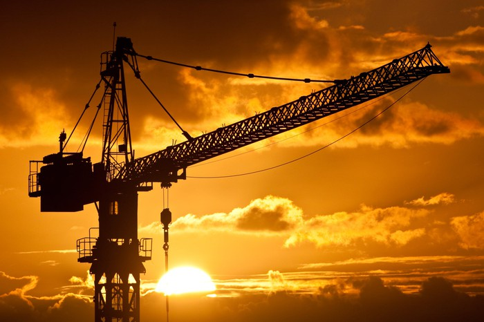 A silhouette of a crane at sunset.