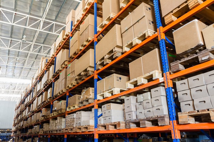 Interior view of a warehouse showing boxes on racks.
