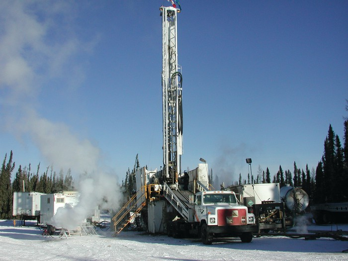 Oil and gas drilling rig under winter conditions in Canada.