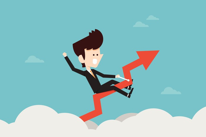 Cartoon of a business person riding a stock chart high above the clouds