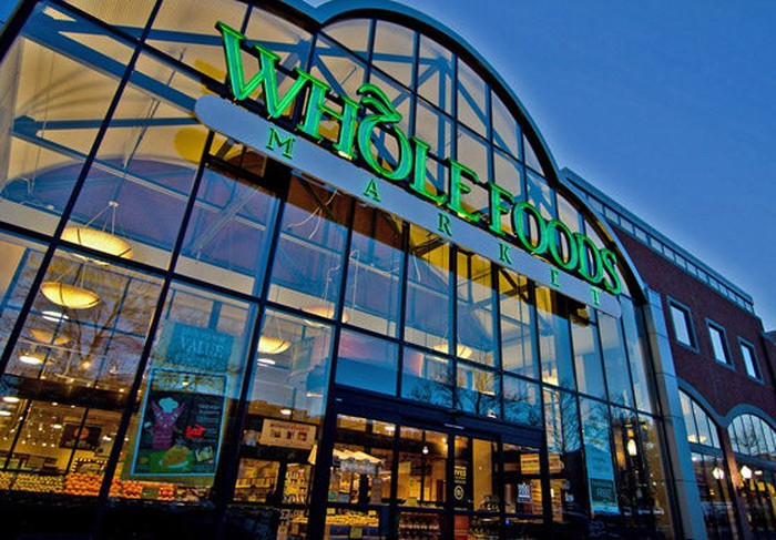 The glass facade of a Whole Foods store in Salt Lake City