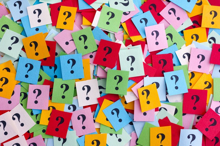 Question marks on multicolored pieces of paper