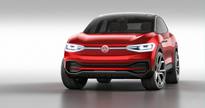 The VW I.D. Crozz II concept, a red SUV, viewed from the front.