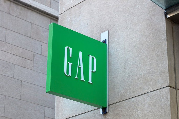 """A green """"Gap"""" sign on a building"""