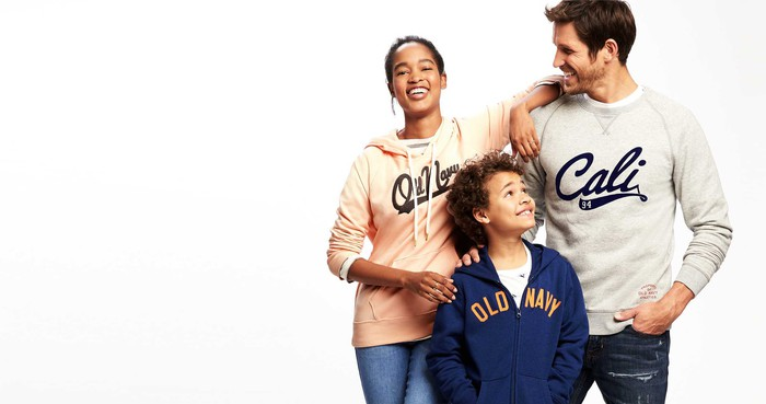 A man, teenage girl, and young boy posing together in Old Navy apparel.