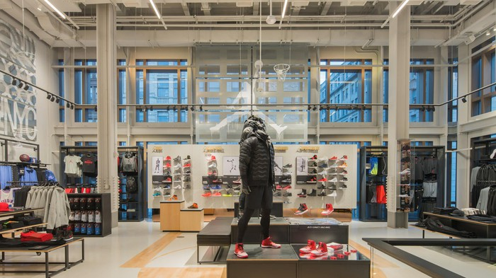 View from inside Nike's New York Soho district store, with high ceilings, lots of windows, and products prominently displayed.