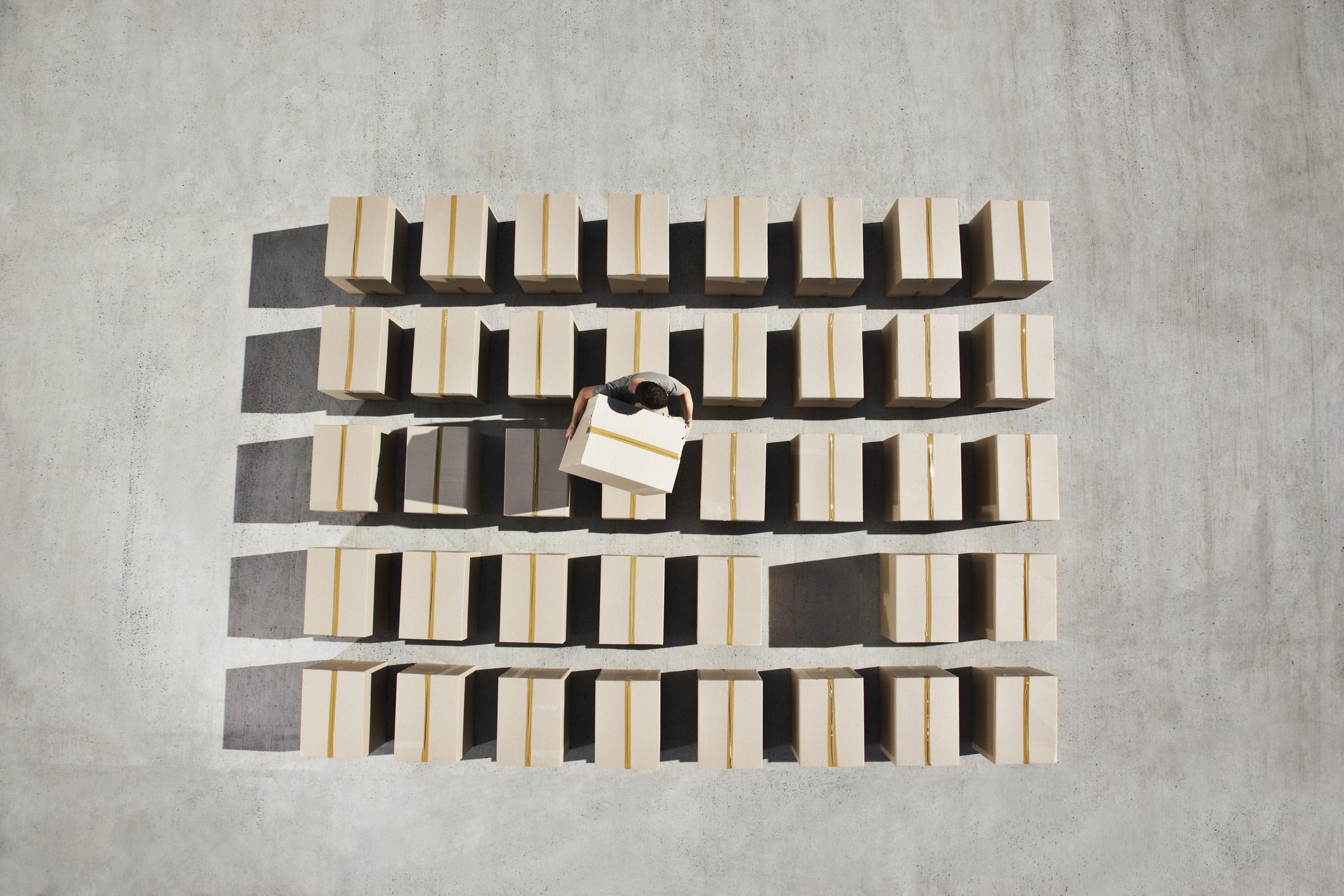 Man arranging boxes