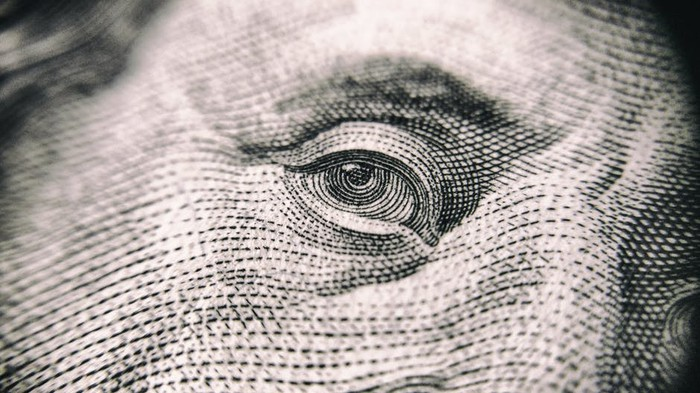 Close-up of Benjamin Franklin's eye on a $100.