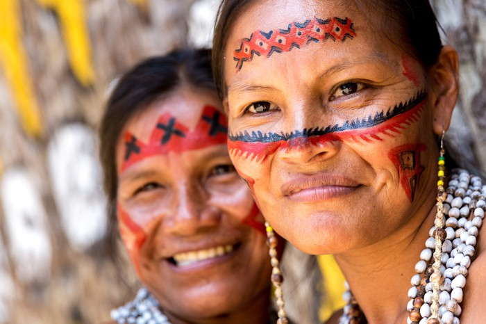 Two indigenous Brazilian women smiling.