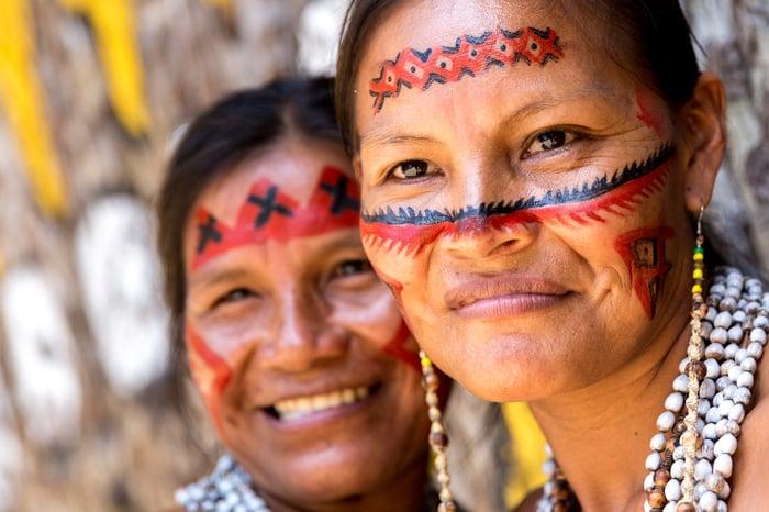 Two indigenous Brazilian women smiling.