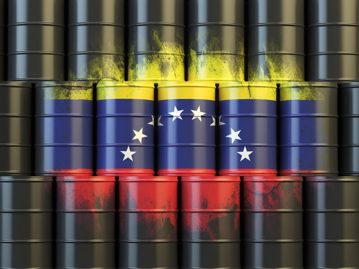 Venezuelan flag painted on oil barrels.