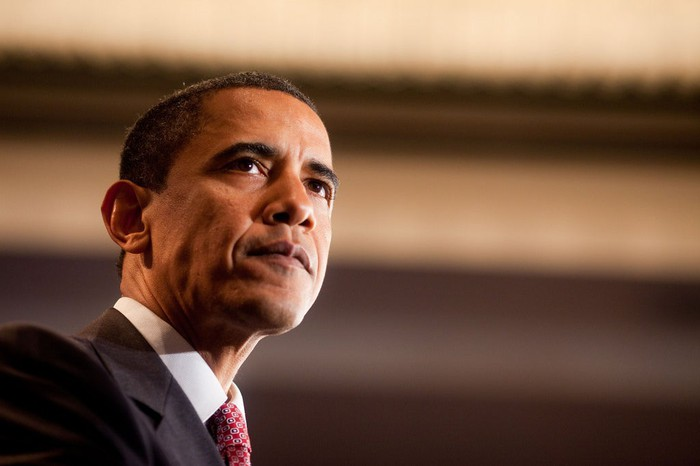 Former President Barack Obama speaking to an audience.