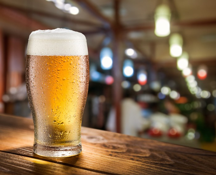 A cold beer with a nice frothy head in a glass