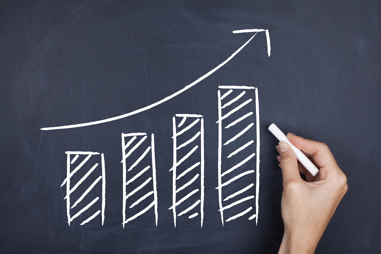 Chalkboard sketch of a bar chart highlighting growth.