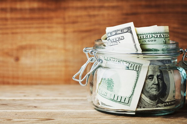 jar full of hundred dollar bills money savings