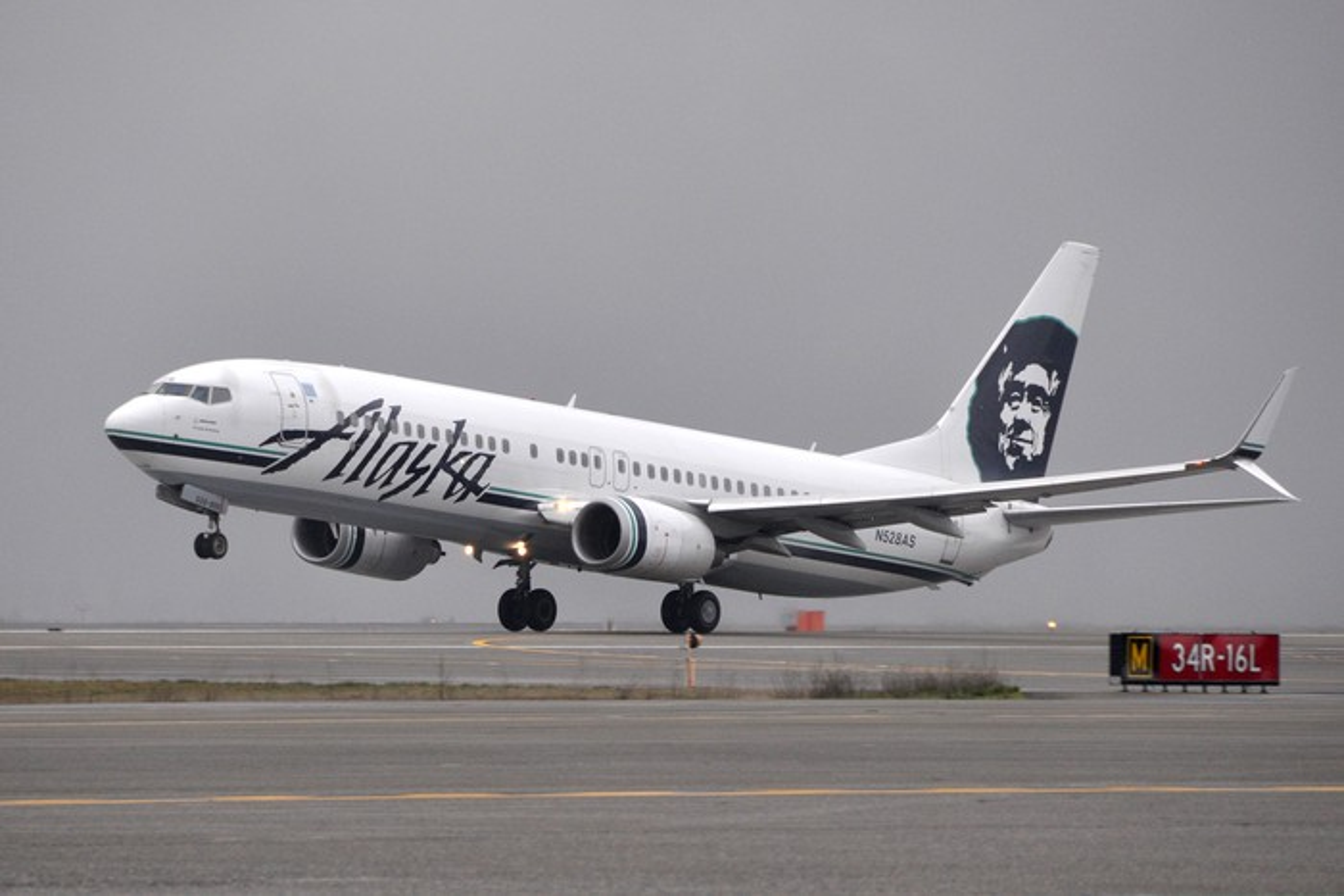 An Alaska Air plane taking off.