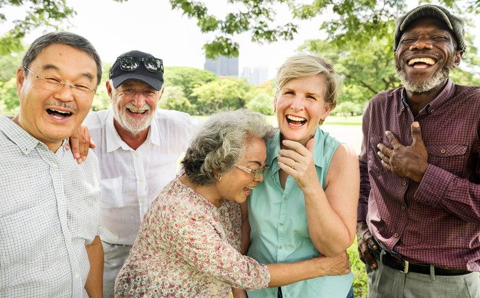 A group of elderly friends laughing