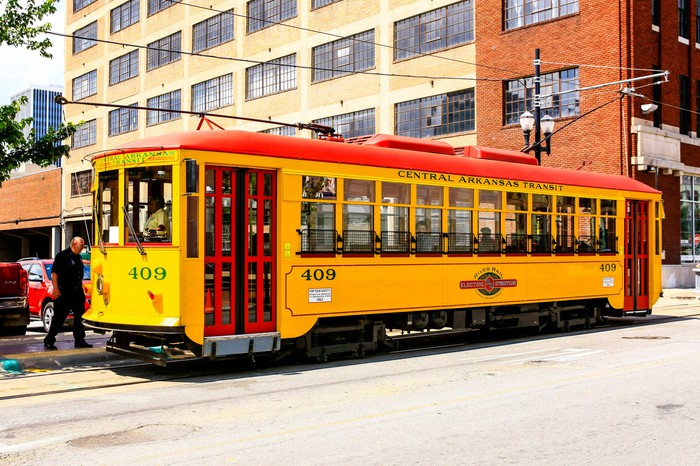 Bright yellow vintage city streetcars in downtown Little Rock Arkansas