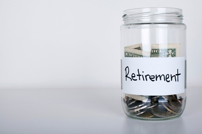 """Jar of coins and bills marked """"retirement."""""""