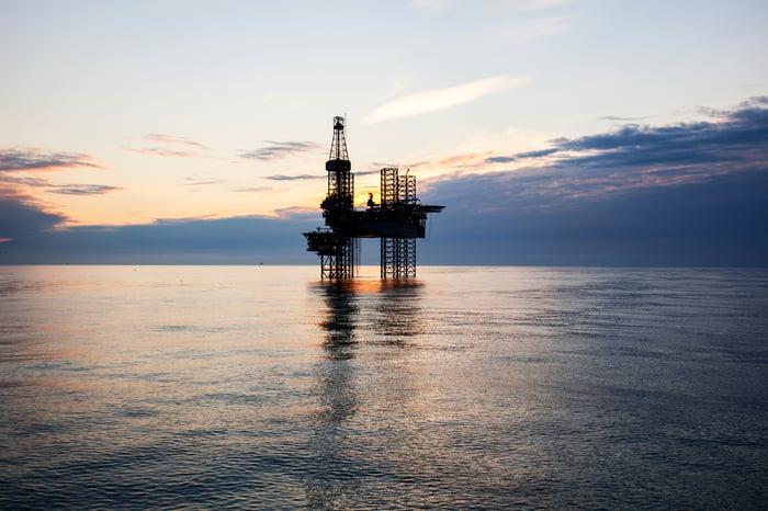 A drilling rig at sea.