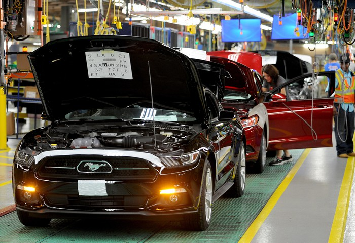 Nearly finished Ford Mustangs are shown on an assembly line at Ford's factory in Flat Rock, Michigan.