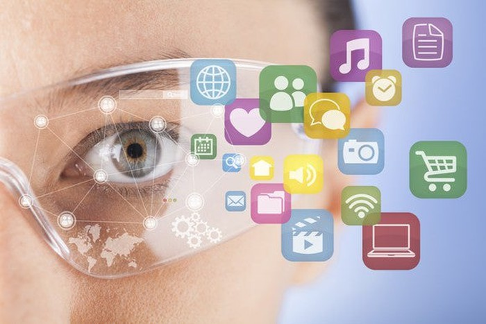 A woman wearing AR glasses, with colorful icons showing the information she is interacting with.
