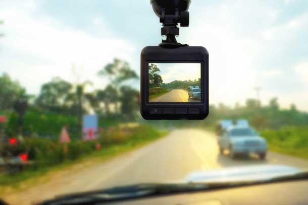 A DVR dash cam recording the road.