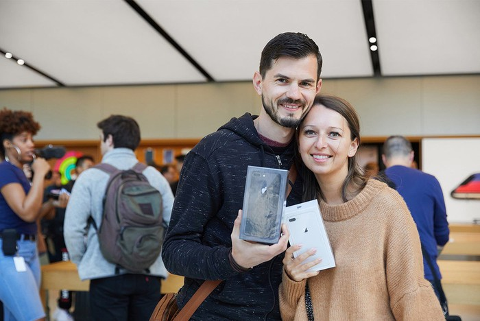 Two Friday morning shoppers with new iPhones at the Union Square Apple Store in San Francisco.