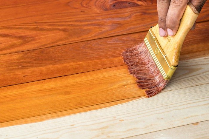 Wooden surface being stained