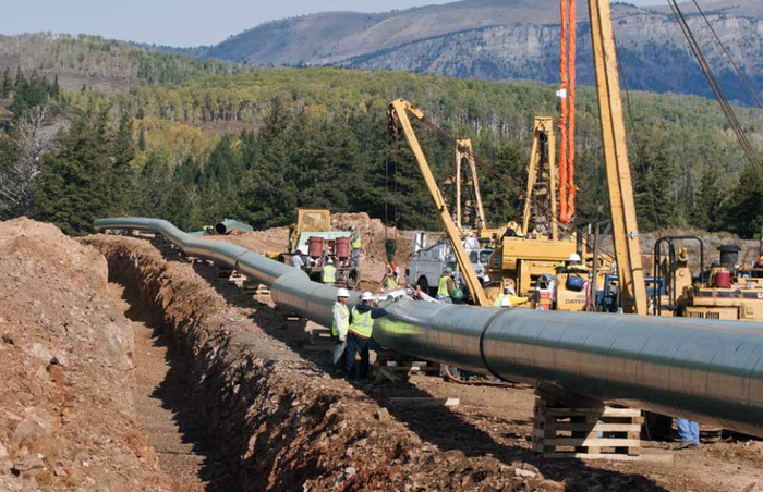 A natural gas pipeline being installed.